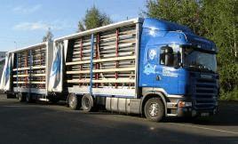 Transport des containers en kit à plat dans un camion